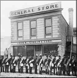 Oddfellows march past the MacGibbon general store